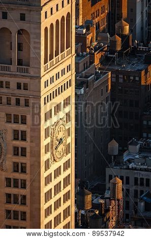 New York Skyscraper At Sunset With Rooftop Wooden Water Tanks