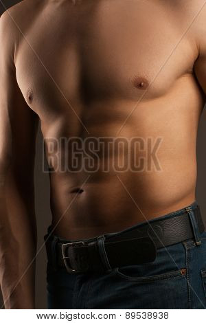 Body Of A Man In The Studio. Relief Abdominal Muscles.