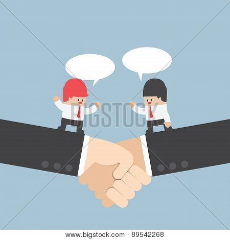 Businessman Talking With Partnership On A Handshake