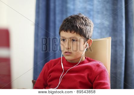 Young boy looks blankly at computer