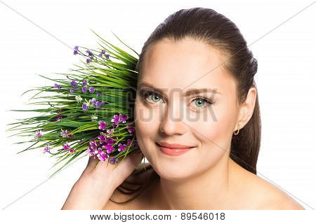 Portrait Of Beautiful Woman With Green Eyes And Spring Flowers