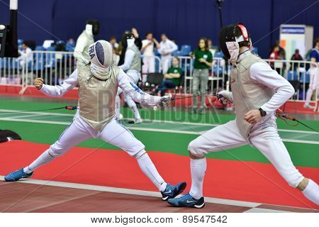 ST. PETERSBURG, RUSSIA - MAY 1, 2015: Vincent Simon of France vs Pavlo Syrachynskyy of Ukraine during International fencing tournament St. Petersburg Foil. The tournament is the stage of FIE World Cup