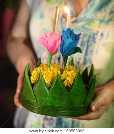 Woman Holding Boat With Candles And Flowers Are Given For Thailands Traditional Loy Krathong Festiva