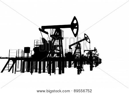 Silhouettes oil pump-jacks. Isolated