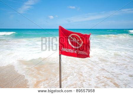 A no swimming danger sign at the beach
