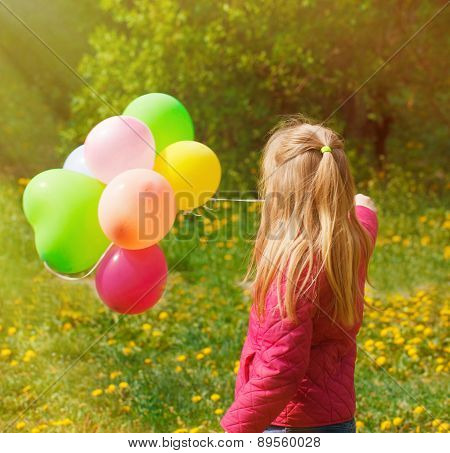 little  girl Turned back with balloons