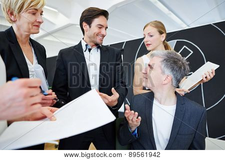 Business team having discussion in office with the manager
