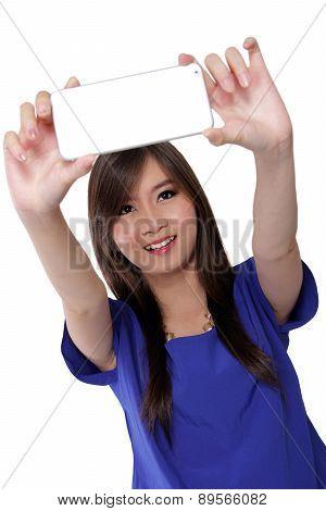 Cute Asian girl taking selfie, isolated on white