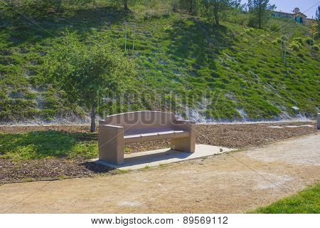 Park Bench And Hillside