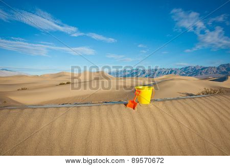 Toy Bucket and Shovel on Sand Dune