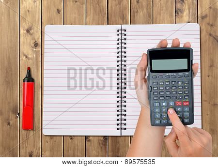 Hands with calculator