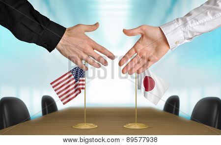 United States and Japan diplomats agreeing on a deal