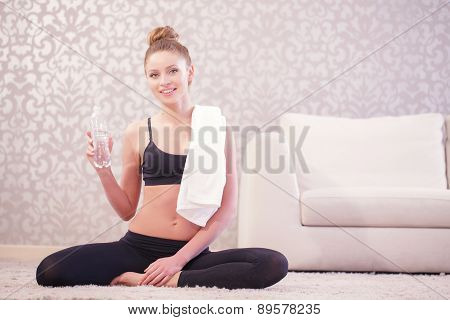 Young woman having rest after sport exercises