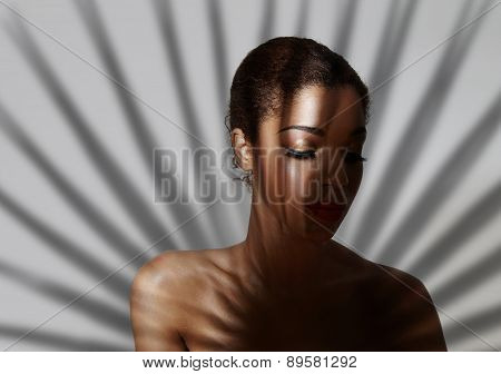 Golden Eyeshadow On A Woman's Fase In Palm Shadow