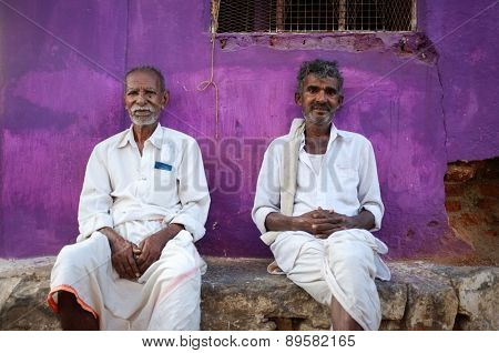 KAMALAPURAM, INDIA - 02 FABRUARY 2015: Local indian men siiting infront of home in a town close to Hampi