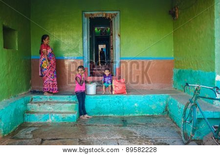 KAMALAPURAM, INDIA - 02 FEBRUARY 2015: Indian family outside their home in a town close to Hampi