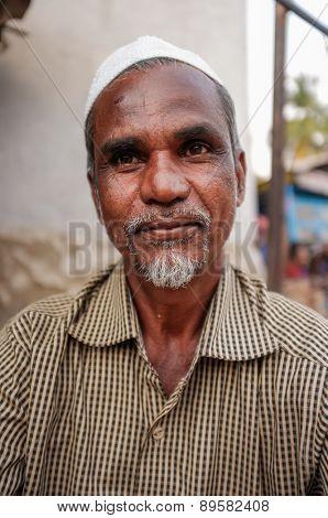 KAMALAPURAM, INDIA - 02 FEBRUARY 2015: Middle-aged indian man with a religious cap