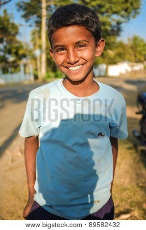 HAMPI, INDIA - 01 FEBRUARY 2015: Indian boy on street with photographers shadow on shirt