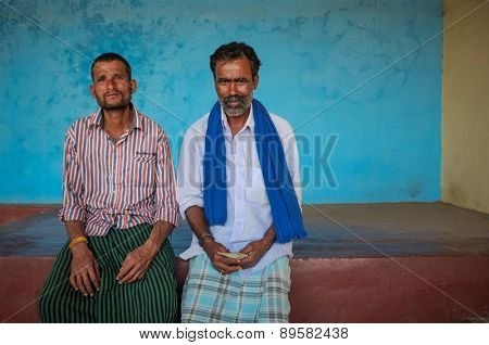 KAMALAPURAM, INDIA - 02 FEBRUARY 2015: Indian men sitting under a covered space on a market close to Hampi