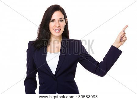 Caucasian businesswoman with finger pointing up