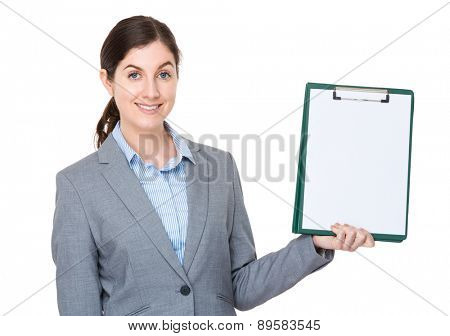 Businesswoman showitng blank page of clipboard