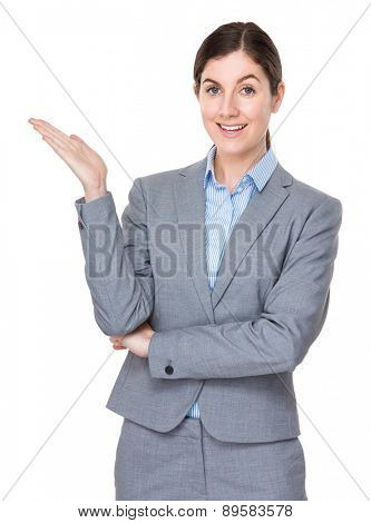 Brunette businesswoman with hand showing soemthing