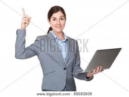 Businesswoman use of laptop and finger pointing up