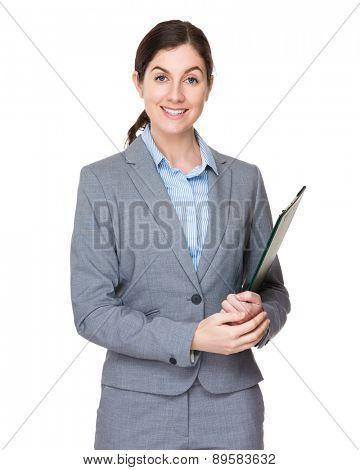 Caucasian businesswoman holding clipboard