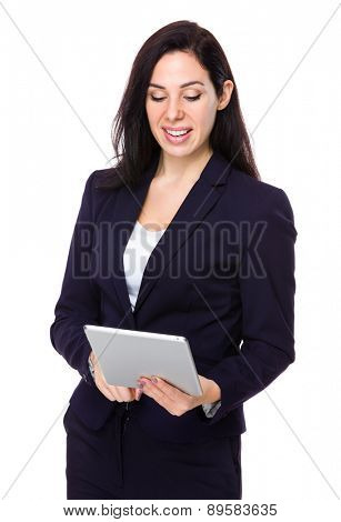 Brunette Businesswoman use of digital tablet