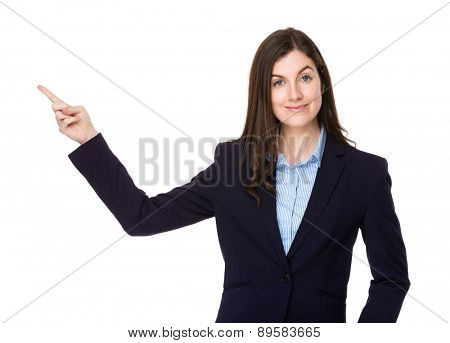 Caucasian businesswoman show with finger point upwards