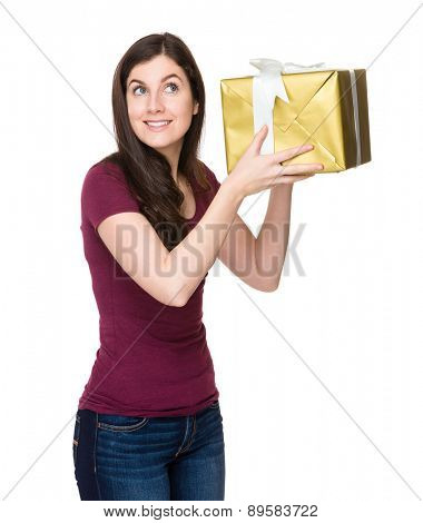 Brunette woman check on gift box