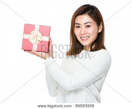 Young woman show with giftbox