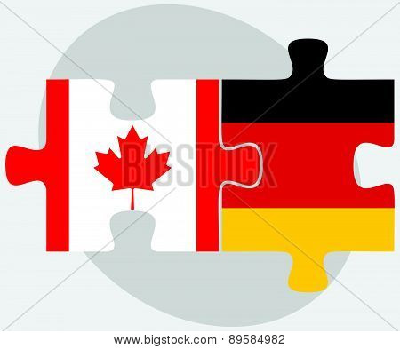 Canada And Germany Flags In Puzzle