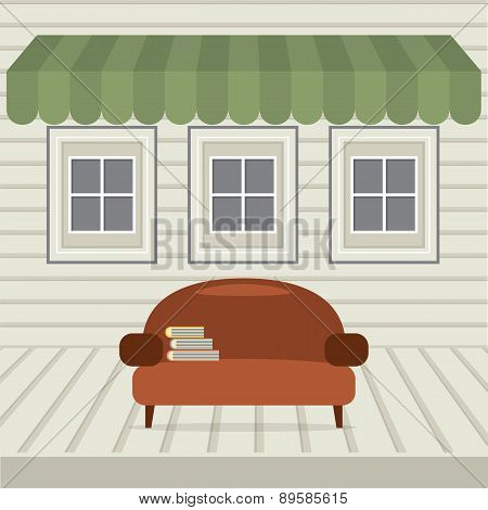 Empty Sofa With Books Under Awning And Windows.