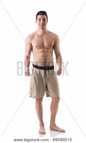 Full figure shot of handsome shirtless young man