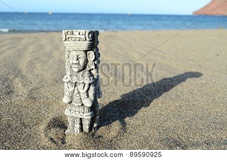 Ancient Maya Statue on the Sand Beach