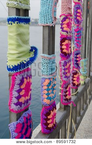 Knitted ornaments on a metal fence on Angara river embankment. Irkutsk