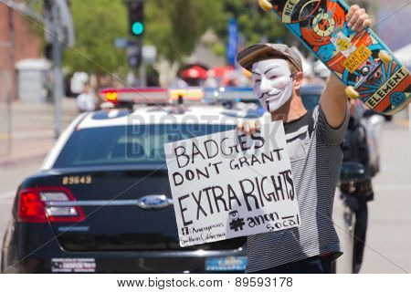 Masked Man Holding Poster