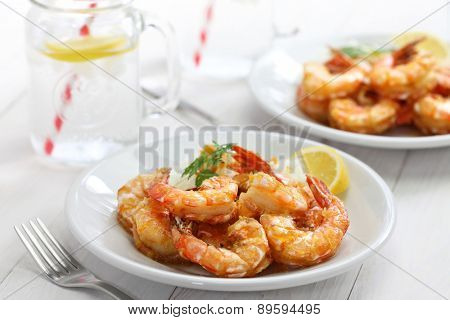 garlic shrimp, hawaiian food on white wooden background