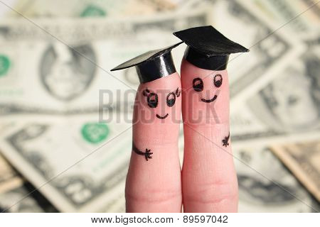 Face painted on the fingers. students holding their diploma after graduation on the background of do