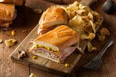 stock photo of sandwich  - Homemade Traditional Cuban Sandwiches with Ham Pork and Cheese - JPG