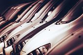 pic of parking lot  - New Cars For Sale in a Row Closeup Photo - JPG