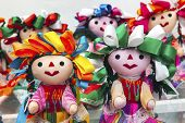 stock photo of guadalupe  - Colorful Lupita Dolls named after Guadalupe Mexico Souvenirs - JPG