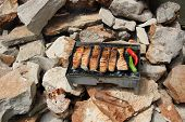 stock photo of brazier  - fresh red fish fried on a brazier with hot coals - JPG