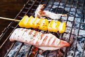 foto of squid  - Close up fresh squid barbeque grilled on charcoal stove - JPG
