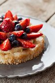 picture of custard  - Delicious homemade tartlete with custard and berries