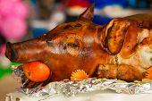 stock photo of banquet  - Decorated and roast suckling pig on a table on banquet - JPG