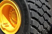 stock photo of wheel loader  - Close view at the wheel of a tire - JPG