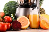 stock photo of juicer  - Slow juicer with organic fruits and vegetables isolated on white - JPG