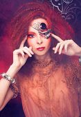 image of woman dragon  - Smoke and young ginger woman with artistic visage - JPG